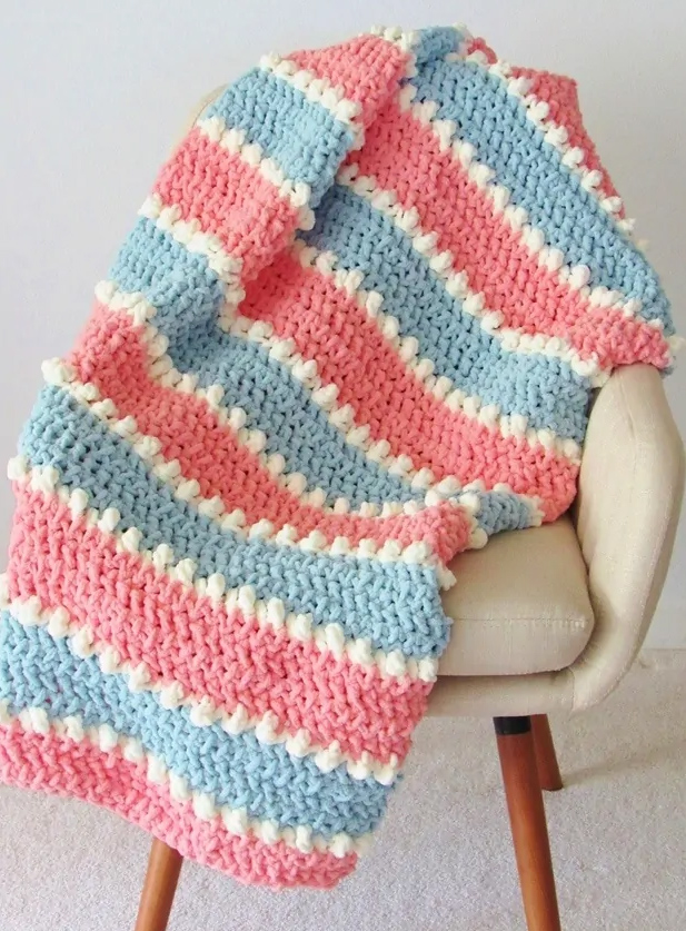 This easy crochet baby blanket pattern is perfect for beginners.