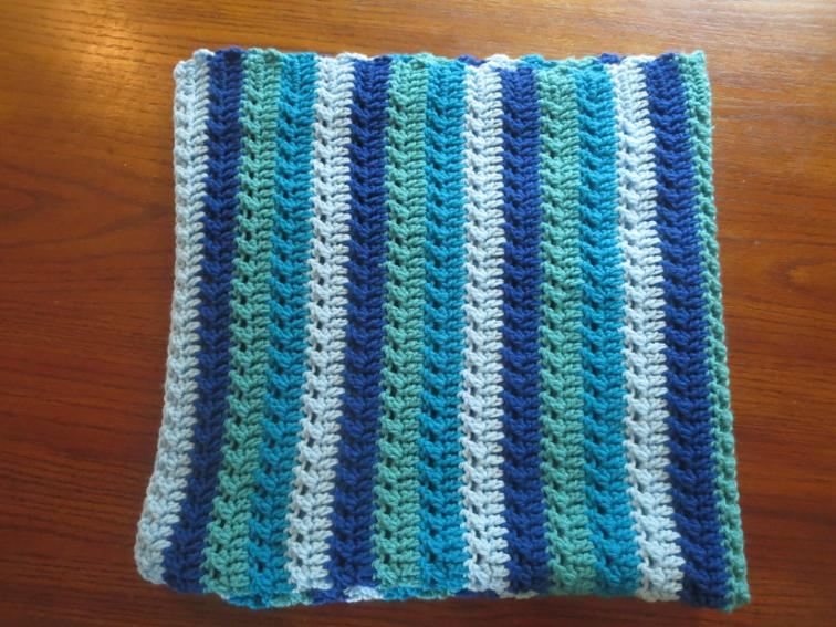 A simple design yet creates a beautiful sophisticated blanket! Perfect for a beginner - it's made using only single and double crochet stitches!