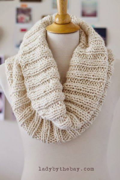 This cozy ribbed knit scarf pattern is made using a simple 2x2 rib stitch using two skeins of chunky alpaca yarn. It knits up quickly and makes a wonderful gift to give to someone special.