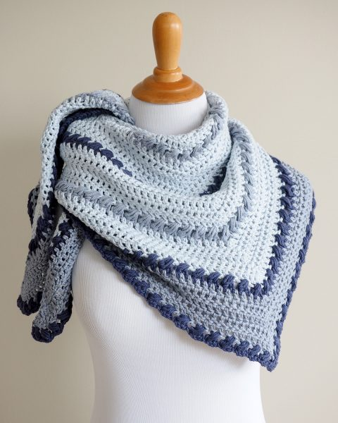 The puff stitch crochet shawl pattern is made from the top down and has very simple steps to increase the stitches in each row.